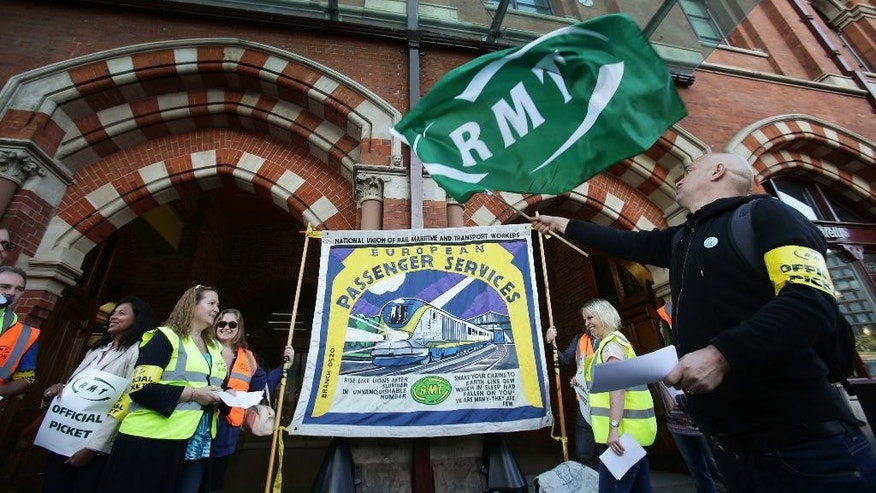 A union picket line outside St. Pancras International train station in London, as Eurostar workers begin a four-day strike, Friday Aug. 12, 2016.  Dozens of train managers on Eurostar services traveling under the English Channel to France have walked off the job in a dispute over working conditions, although the company predicts the strike will have only limited effect on its schedule. (Yui Mok / PA via AP)