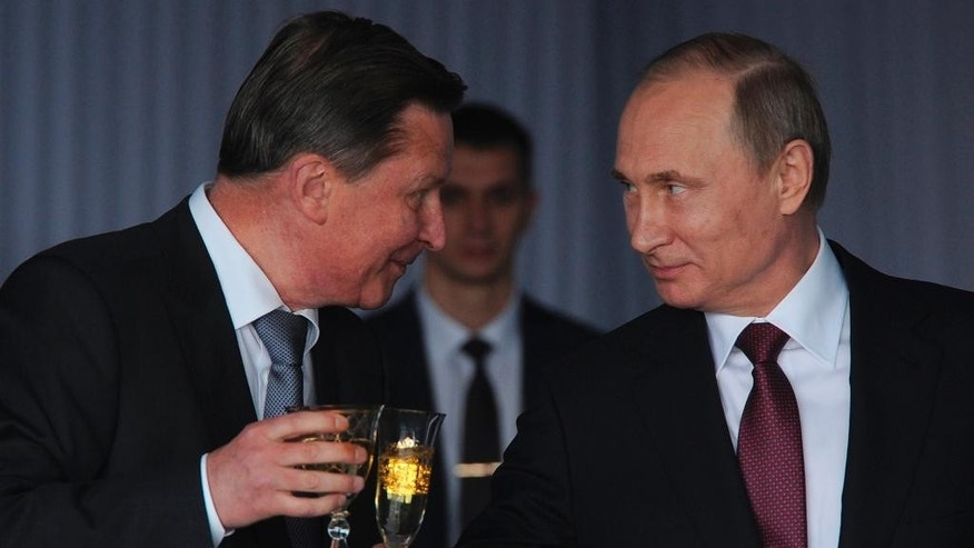 FILE - In this Sunday, June 12, 2016, file photo Russian President Vladimir Putin, right, toasts with chief of president's staff Sergei Ivanov during a reception celebrating the Day of Russia at the Kremlin in Moscow, Russia.  Putin has fired his chief of staff Sergei Ivanov having said it's been done at Ivanov's request because he had been too long in the job, and he is also taken off the Security Council, Russia's top security body. (Mikhail Klimentyev, Sputnik, Kremlin Pool Photo via AP)