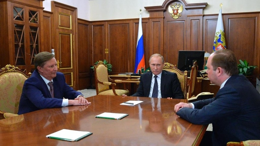 Russian President Vladimir Putin, center, meets with the new Chief of the presidential administration, Anton Vayno, right, and the outgoing Kremlin Chief of Staff, Sergei Ivanov, in the Kremlin in Moscow, Russia, Friday, Aug. 12, 2016. Russian President Vladimir Putin on Friday fired Sergei Ivanov, his chief of staff and one of his closest allies, in the most high-profile power reshuffle at the Kremlin in years. (Alexei Druzhinin/Sputnik, Kremlin Pool Photo via AP)