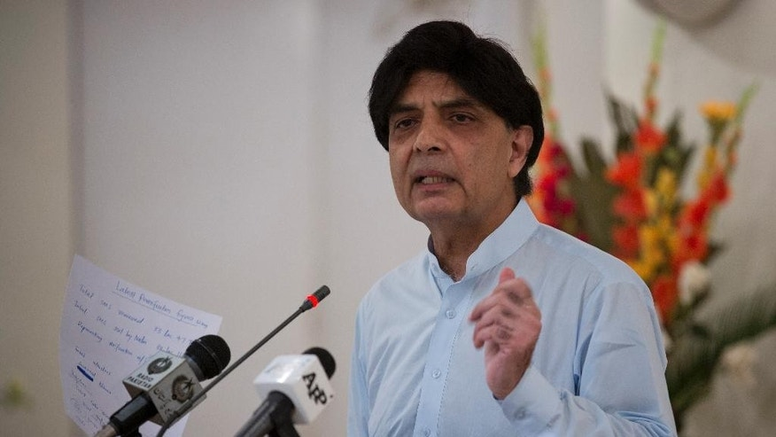 Pakistan's Interior Minister Chaudhry Nisar Ali Khan says, a blacklisted American citizen Matthew Barrett will be deported once a joint interrogation team completes its work while addressing a news conference in Islamabad, Pakistan, Friday, Aug. 12, 2016. Barrett, a 33-year-old Alabama native had lived in Pakistan for four years, married a Pakistani woman and had two children. He was expelled from the country in 2011 after being found near a sensitive military installation. (AP Photo/B.K. Bangash)