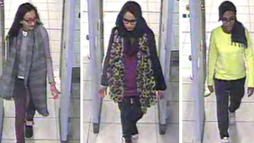 "FILE - This is a Monday Feb. 23, 2015 file handout image  of a three image combo of stills taken from CCTV issued by the Metropolitan Police  Kadiza Sultana,  left, Shamima Begum, centre and and  Amira Abase going through security at Gatwick airport, before they caught their flight to Turkey. A lawyer said one of three London schoolgirls who traveled to Islamic State-controlled area of Syria to become ""jihadi brides"" is believed to have been killed in an air strike. Tasnime Akunjee told the BBC Friday Aug. 12, 2016 that Kadiza Sultana's family had been told that she died in the IS stronghold of Raqqa several weeks ago. (Metropolitan Police via AP)"