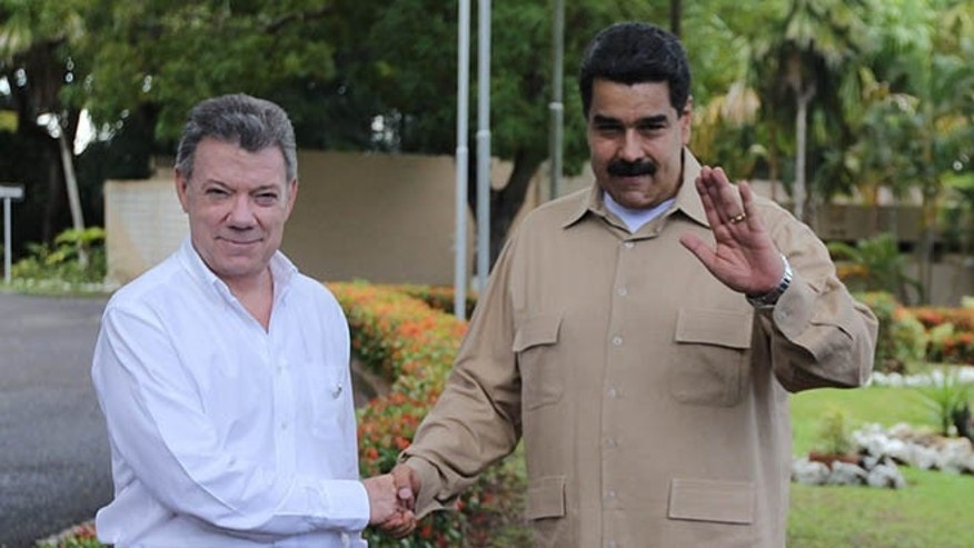 Venezuela's President Nicolas Maduro, right, and Colombian counterpart Juan Manuel Santos, in Puerto Ordaz, Venezuela, Thursday, Aug. 11, 2016.