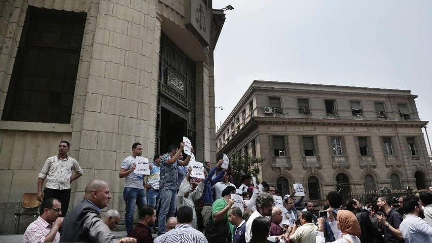 Egyptians protest against the latest surge of assaults on Christians in Cairo, Egypt, Saturday, Aug. 13, 2016. Egyptian Christians have staged a rare protest in downtown Cairo to demand the government uphold their rights, saying they are sorely lacking and they are treated as second-class citizens in the Muslim-majority country. (AP Photo/Nariman El-Mofty)