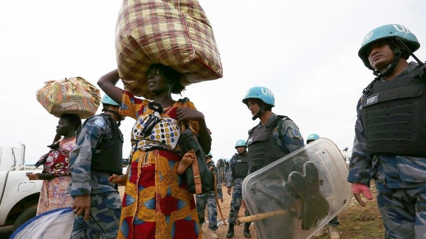 In this photo taken Wednesday, July 13, 2016, and released by the United Nations Mission, as South Sudan is softening its rejection of a regional protection force a day after the U.N. Security Council voted to deploy 4,000 additional peacekeepers. The South Sudan government spokesman says it will accept the protection force only if it can negotiate the size, mandate, weapons and contributing countries, and saying neighboring Uganda, Sudan, Ethiopia and Kenya cannot take part. (Eric Kanalstein/UNMISS via AP)