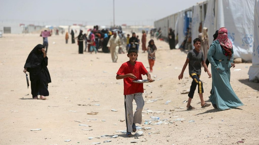 In this photo taken on Saturday, June 25, 2016, Internally displaced civilians, who fled their homes during fighting between Iraqi security forces and Islamic State group, to a camp at Amariyah Fallujah, Iraq. As Iraqi political and military attention shifts north in the fight against the Islamic State group, the military victories that have put Iraqi forces on Mosul's doorstep have left behind shattered cities, towns and communities in Iraq's Sunni heartland. (AP Photo/ Khalid Mohammed)