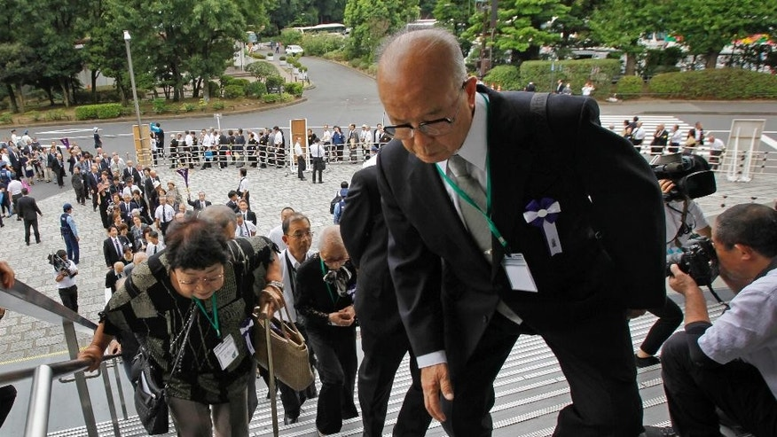 Bereaved family members arrive for a national memorial ceremony for the war dead at Nippon Budokan martial arts hall in Tokyo, Monday, Aug. 15, 2016. Japan marked Monday the 71st anniversary of the end of World War II.(AP Photo/Shuji Kajiyama)