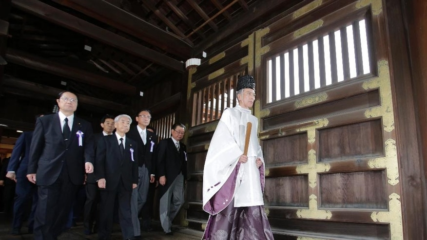 Japanese lawmakers visit the Yasukuni Shrine in Tokyo to offer prayers to the war dead Monday, Aug. 15, 2016. Japan marked the 71st anniversary of the end of World War II. (AP Photo/Shizuo Kambayashi)