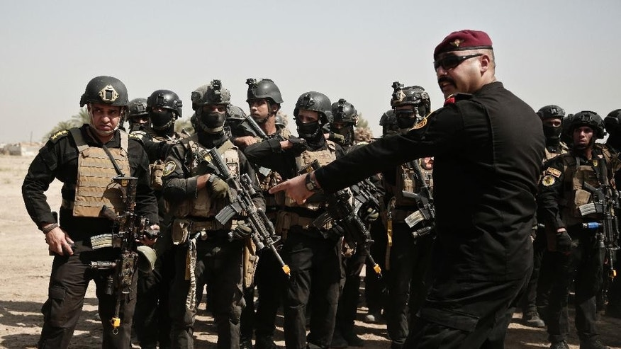 In this Saturday, Aug. 13, 2016 photo, a soldier from the 1st Battalion of the Iraqi Special Operations Forces takes part in during a training exercise to prepare for the operation to re-take Mosul from Islamic State militants, in Baghdad, Iraq. Iraq's leaders have repeatedly promised that Mosul — which has been in the hands of IS militants for more than two years now — will be retaken this year. (AP Photo/Maya Alleruzzo)