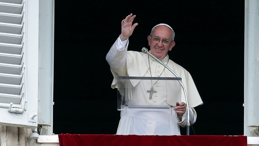 Pope Francis waves at Saint Peter's Square on Sunday.