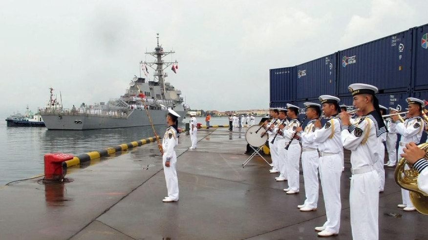 FILE  - In this Aug. 8, 2016 file photo, a Chinese military band plays as the guided missile destroyer USS Benfold arrives in port in Qingdao in eastern China's Shandong Province in the first visit by an American warship to the country since Beijing responded angrily to an arbitration panel's ruling that its expansive South China Sea maritime claims had no basis in law. A senior Chinese diplomat made clear Monday, Aug. 15, that Beijing wants next month's meeting of leaders of the Group of 20 major economies to avoid political issues such as its territorial disputes with its neighbors in the South China Sea. (AP Photo/Borg Wong, File)