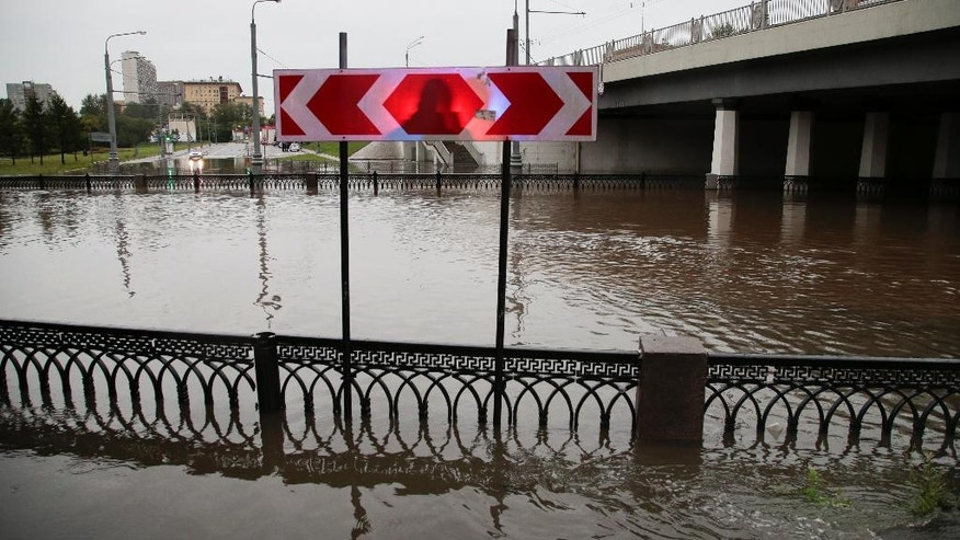 A view of the river after it overflowed its banks in Moscow, Russia, Monday, Aug. 15, 2016. Heavy rain caused a river to burst its banks, flooding streets and trapping people in cars and buses. Russian state news media reported that about 200 people had to be evacuated from stalled vehicles. (AP Photo/Ivan Sekretarev)