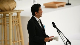 Japan's Prime Minister Shinzo Abe delivers a speech during a national memorial service at Nippon Budokan martial arts hall in Tokyo, Monday, Aug. 15, 2016. Japan marked Monday the 71st anniversary of the end of World War II. (AP Photo/Shuji Kajiyama)