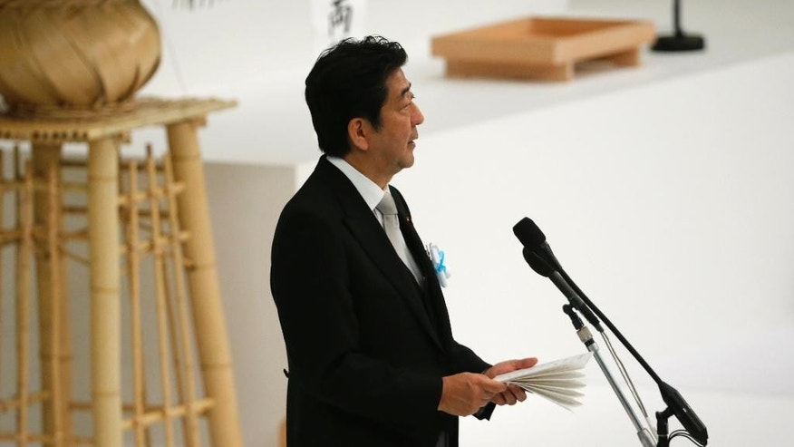 Japan's Prime Minister Shinzo Abe delivers a speech during a national memorial service at the Nippon Budokan martial arts hall in Tokyo Monday.