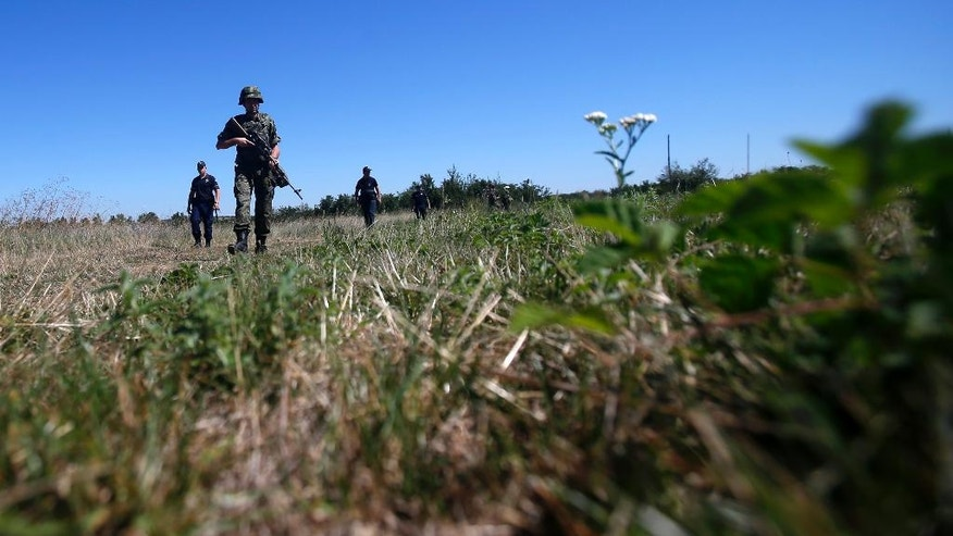 Serbian army soldiers and border police officers patrol near the border between Serbia and Bulgaria, not far from the border crossing Vrska Cuka, some 250 km (155 miles) southeast of Belgrade, Serbia, Monday, Aug. 15, 2016. Serbia has recently deployed joint army and police patrols on its border with Bulgaria where migrants are crossing the border, mostly guided by people smugglers. (AP Photo/Darko Vojinovic)