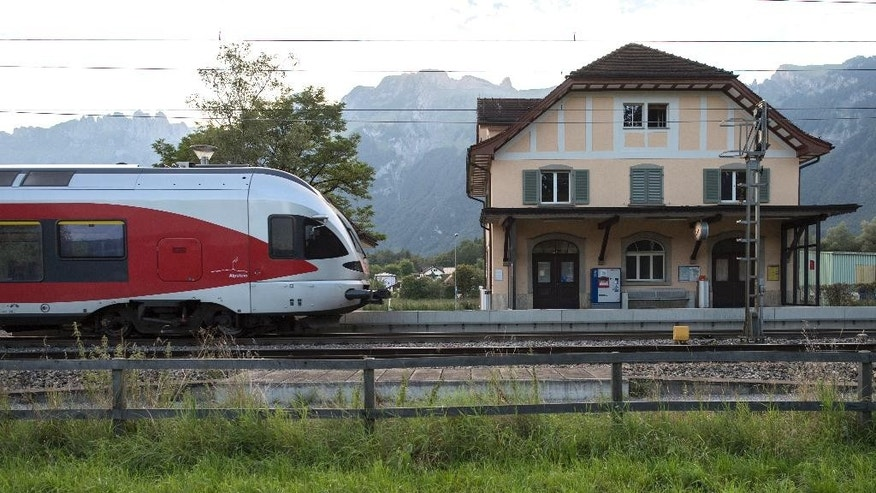 The train station Salez - Sennwald  photographed  in Salez, Switzerland, on Sunday Aug. 14, 2016. The man who attacked passengers on a crowded Swiss train with a knife and burning liquid died of his wounds Sunday, as did one of his victims, a 34-year-old woman, Swiss police said. Three others remain hospitalized with serious wounds. Police are still searching for a motive but said there's no indication the suspect, identified only as a 27-year-old Swiss man from a neighboring region, had ties to extremist groups.   (Gian Ehrenzeller/Keystone via AP)