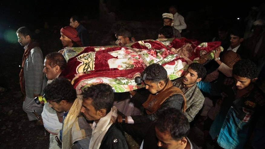In this July, 24, 2016 photo, mourners carry the body of Youssef al-Salmi, 10, who was killed when a bomb exploded while he was playing with it near his family's house in Hasn Faj Attan village, in the mountainous outskirts of Sanaa, Yemen. He became the latest of several Yemeni civilians to be killed by unexploded ordnance from the country's ongoing civil war, which pits Saudi and U.S.-backed government forces against Shiite Houthi rebels. Rights groups and U.N. agencies have expressed concern that even if the fighting is brought to an end, the country will still grapple with a brutal legacy of unexploded munitions. (AP Photo/Hani Mohammed)
