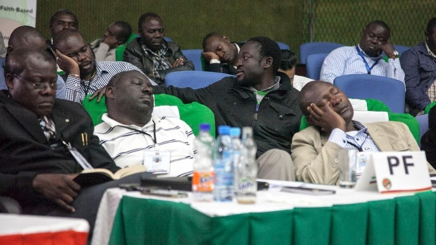 Officials of the ruling party nap as they await results of the presidential elections in Lusaka, Monday, Aug. 15, 2016. Zambia's president Edgar Lungu led Monday in nearly complete results from an election whose vote-counting process has taken days and prompted opposition allegations of irregularities. (AP Photo/Moses Mwape)