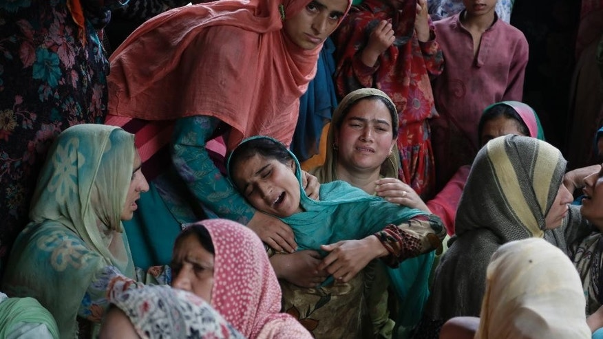 An unidentified family member of a killed civilain cries during a joint funeral of four civilians at Aripanthan village, west of Srinagar, Indian controlled Kashmir, Tuesday, Aug.16, 2016. Government forces in Indian-controlled Kashmir shot and killed four civilians and injured at least 15 others Tuesday as clashes intensified with anti-India protesters in the troubled region, police said. (AP Photo/Mukhtar Khan)