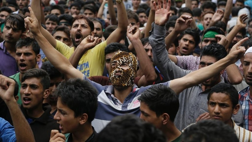 Kashmiris shout pro freedom slogans during a joint funeral of four civilains at Aripanthan village, west of Srinagar, Indian controlled Kashmir, Tuesday, Aug.16, 2016. Government forces in Indian-controlled Kashmir shot and killed four civilians and injured at least 15 others Tuesday as clashes intensified with anti-India protesters in the troubled region, police said. (AP Photo/Mukhtar Khan)