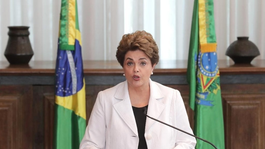 Brazil's suspended President Dilma Rousseff reads a letter to the people and to the Senate from Alvorada Palace, in Brasilia, Brazil, Tuesday, Aug. 16, 2016. President Rousseff is proposing to let Brazilians decide if they want to hold new, early presidential elections if lawmakers restore her to power. (AP Photo/Eraldo Peres)