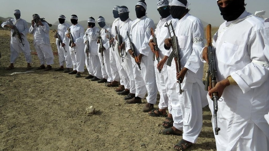 In this Monday, Aug. 15, 2016 photo, Taliban suicide bombers stand guard during a gathering of a breakaway Taliban faction, in the border area of Zabul province, Afghanistan. The faction appointed a new leader for the group, the nephew of the faction's leader who was killed last year. The development was announced in a video that was made available to The Associated Press. It said that Mullah Emdadullah Mansoor was named leader of the faction known as Mahaaz-e-Dadullah at a gathering on Monday in southern Zabul province. The meeting was attended by tribal and religious leaders, as well as the group's local commanders. (AP Photo/Mirwais Khan)
