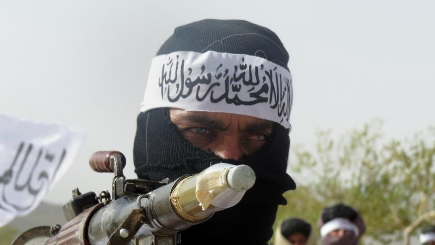 "In this Monday, Aug. 15, 2016 photo, a follower of a breakaway Taliban faction holds a weapon at a gathering, in Zabul province, southern Afghanistan. The faction, known as Mahaaz-e-Dadullah, appointed a new leader for the group, the nephew of the faction's leader who was killed last year. The development was announced in a video that was made available to The Associated Press. It said that Mullah Emdadullah Mansoor was named leader at the gathering on Monday. The meeting was attended by tribal and religious leaders, as well as the group's local commanders. Arabic on headband reads, ""There is no God but Allah and Mohammed is his messenger."" (AP Photo/Mirwais Khan)"