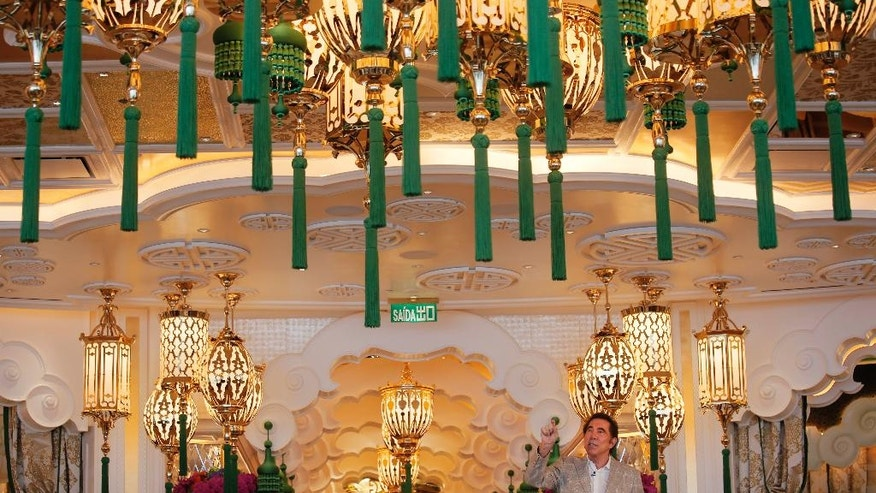 Steve Wynn, CEO of Wynn Palace speaks during a press conference in Macau, China, Wednesday, Aug. 17, 2016. The U.S. casino mogul will be hoping luck is on his side as he prepares to launch his Wynn Palace project in the Asian gambling hub, where growth is downshifting into a new phase after years of turbocharged expansion. (AP Photo/Vincent Yu)