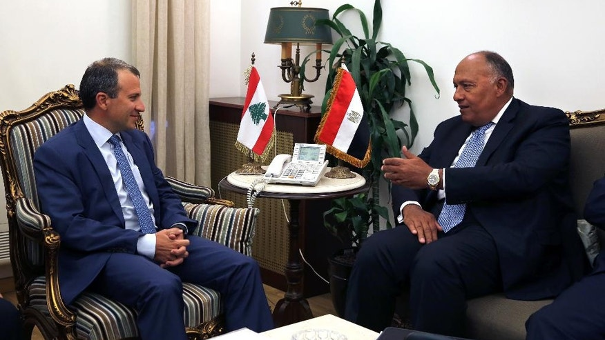 Lebanese Foreign Minister Gibran Bassil, left, meets with his Egyptian counterpart Sameh Shukri, at the Lebanese foreign ministry, in Beirut, Lebanon, Tuesday, Aug. 16, 2016. (AP Photo/Bilal Hussein)