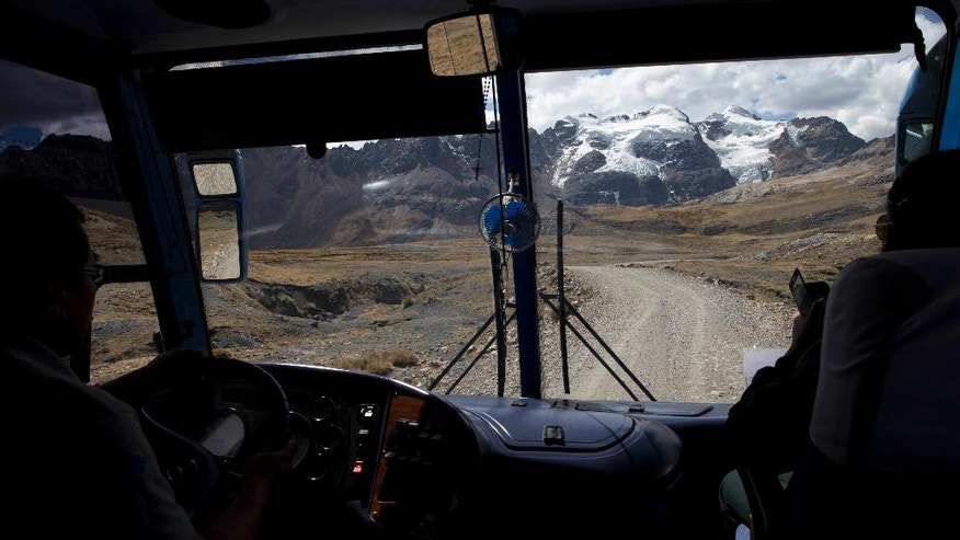 In this Aug. 12, 2016 photo, a glacier is seen from inside a bus in Huaraz, Peru. Peru has 70% of the world's tropical glaciers and facing imminent water resource issues while glaciers retreat. (AP Photo/Martin Mejia)