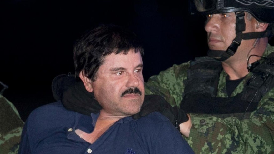 "FILE - In this Jan. 8, 2016, file photo, Mexican drug lord Joaquin ""El Chapo"" Guzman is made to face the press as he is escorted to a helicopter in handcuffs by Mexican soldiers and marines at a federal hangar in Mexico City, Mexico. The son of the imprisoned drug lord may be among the half-dozen men abducted by gunmen at a restaurant in the Mexican beach resort of Puerto Vallarta, authorities said Tuesday, Aug 16, 2016. (AP Photo/Marco Ugarte, File)"