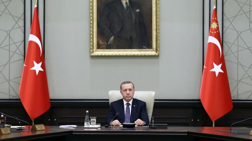 Turkish President Recep Tayyip Erdogan leads a cabinet meeting at the Presidential Palace in Ankara on Monday, Aug. 15, 2016. Police teams on Monday apprehended 136 personnel in operations conducted at three Istanbul courthouses as part of an investigation into the July 15 abortive coup. (Yasin Bulbul/Presidential Press Service via AP)