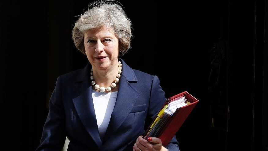 """FILE - In this Wednesday, July 20, 2016 file photo, Britain's Prime Minister Theresa May leaves 10 Downing street to attend her first Prime Ministers Questions at the House of Parliament in London. Prime Minister Theresa May is attempting to allay disquiet about her surprise delay to a Chinese-backed nuclear power plant by reassuring China's leader that Britain wants strong relations with Beijing. Foreign Office Minister Alok Sharma delivered a letter from May to President Xi Jinping during a visit to Beijing. May's office did not publish the letter, but said Tuesday, Aug. 16 it was about """"reassuring the Chinese of our commitment to Anglo-Chinese relations."""" (AP Photo/Frank Augstein, file)"""