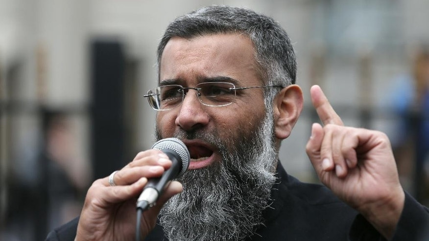FILE - This is a Friday, April 3, 2015  file photo of  Anjem Choudary, a British Muslim social and political activist and spokesman for Islamist group, Islam4UK, speaks following prayers at the Central London Mosque in Regent's Park, London. One of Britain's best known radical Muslim preachers, Anjem Choudary, has been convicted of encouraging support for the Islamic State group. Choudary and co-defendant Mohammed Mizanur Rahman were convicted last month, but the verdict could not be reported until Tuesday Aug. 16, 2016, because of court-imposed restrictions.  (AP Photo/Tim Ireland, File)
