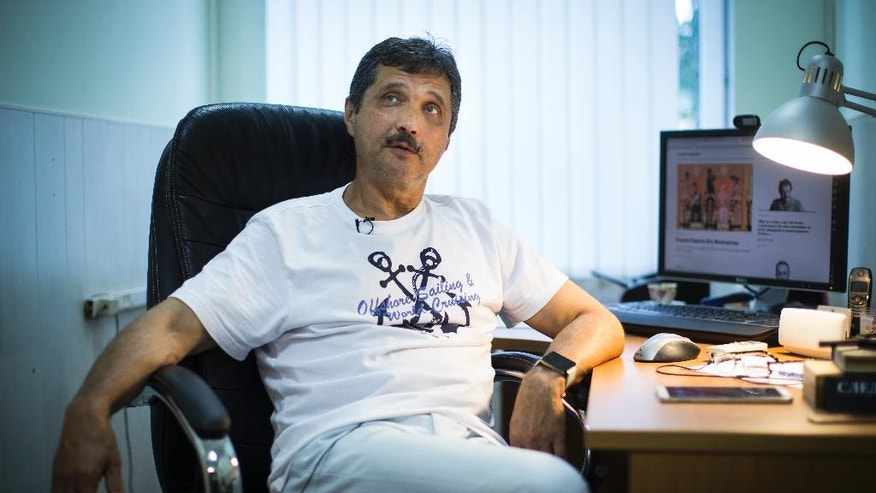 In this photo taken on Tuesday, July 26, 2016, Valery Shiryayev, former KGB staff and senior operative, speaks to the Associated Press in his working room in Novaya Gazeta newspaper in Moscow, Russia. As the 25th anniversary of the so-called August Coup draws near this Friday, The Associated Press has talked to participants and witnesses of those critical days when Muscovites turned out to defend the spirit of democracy that Gorbachev had unleashed, and many Soviet officers defied their orders and sided with the people, ensuring that that the plotters failed.  (AP Photo/Alexander Zemlianichenko)