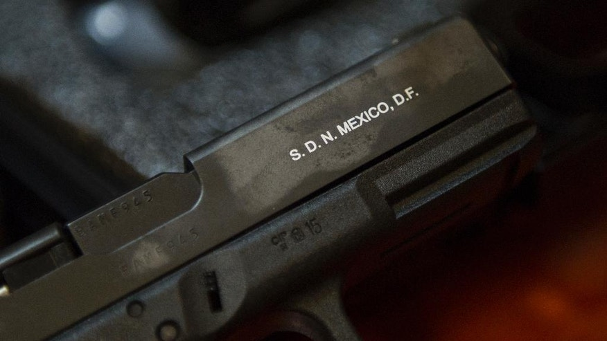 In this July 15, 2016 photo, a Glock pistol is stamped with a marking signifying the gun was purchased from the Army's lone gun store in Mexico City. All firearms must be registered with the Army to be considered legally owned. (AP Photo/Nick Wagner)