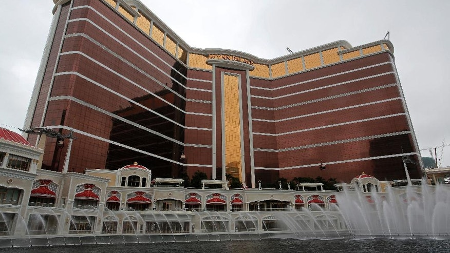 Wynn Palace is seen in Macau, China, Wednesday, Aug. 17, 2016.  From a pair of giant golden dragons encircling a vast man-made lagoon to phoenix and cloud motifs inside, Steve Wynn's Macau resort brims with auspicious Chinese symbolism. The U.S. casino mogul will need luck on his side as launches his $4.2 billion Wynn Palace project in the gambling hub on China's southern coast, where growth is downshifting after years of turbocharged expansion.  (AP Photo/Vincent Yu)