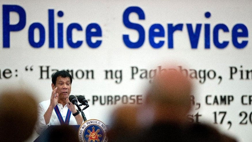 Philippine President Rodrigo Duterte gestures as he talks during the 115th Police Service Anniversary at the Philippine National Police (PNP) headquarters in Manila Wednesday, Aug. 17, 2016.  The brash-talking Philippine president criticized the United Nations Wednesday for condemning the spate of killings of suspected drug criminals in the country, but allegedly remaining silent on bombings in the Middle East that have killed entire villages and communities. (Noel Celis/Pool Photo via AP)