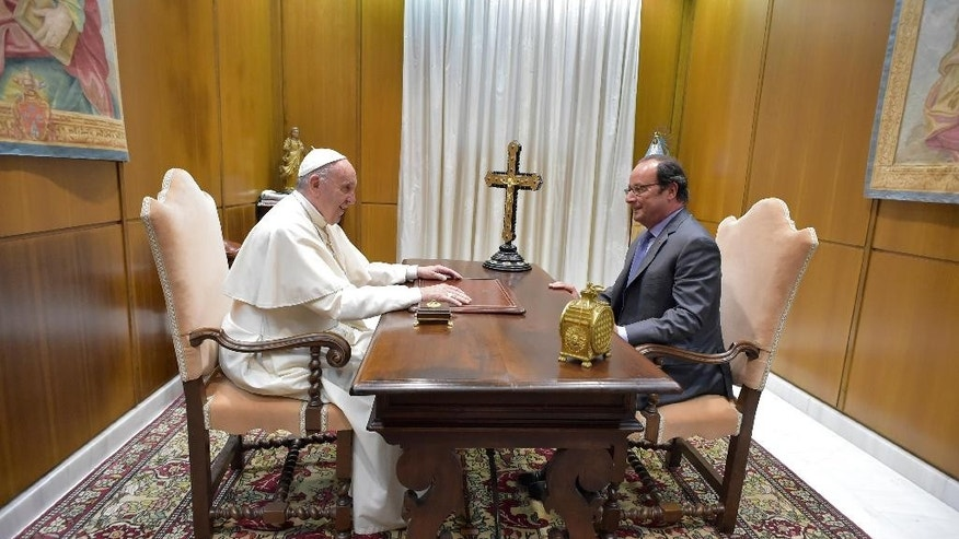 Pope Francis, left, and French President Francois Hollande meet at the Vatican, Wednesday, August 17, 2016, during a special audience after a spate of Islamic extremist attacks over recent months left more than 200 dead, including an elderly French priest. (L'Osservatore Romano/pool photo via AP)