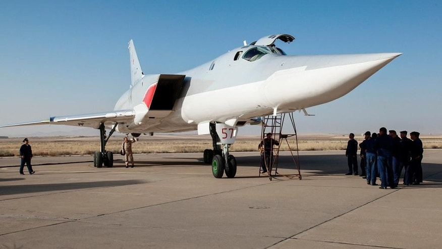In this photo taken on Monday, Aug. 15, 2016, A Russian Tu-22M3 bomber stands on the tarmac at an air base near Hamedan, Iran. Russian warplanes took off on Tuesday Aug. 16, from Iran to target Islamic State fighters and other militants in Syria, widening Moscow's bombing campaign in Syria.(WarfareWW Photo via AP)