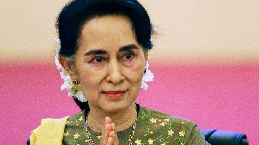 FILE - In this July 29, 2016, file photo, Myanmar's Foreign Minister Aung San Suu Kyi greets leaders of armed ethnic groups during their meeting at a hotel in Naypyitaw, Myanmar. Suu Kyi on Wednesday, Aug. 17, 2016, began a formal five-day visit to China to bolster ties with her country's dominant northern neighbor. It's her first trip to China since her party won a historic majority in 2015. (AP Photo/Aung Shine Oo, File)