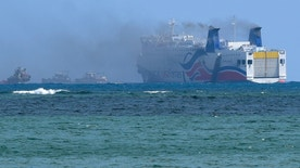 Smokes spills from the the cruise ship Caribbean Fantasy off the coast of San Juan, Puerto Rico, Wednesday, Aug. 17, 2016. Authorities in Puerto Rico say more than 500 passengers have been evacuated after a small fire erupted on a cruise ship that runs between Puerto Rico and the Dominican Republic. (AP Photo/Carlos Giusti)