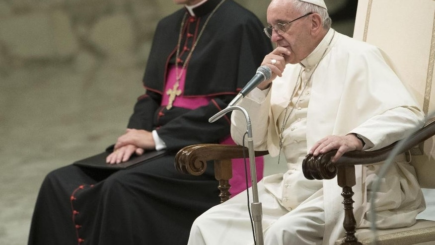 Pope Francis sits during his weekly general audience at the Vatican, Wednesday, Aug. 17, 2016. (Giorgio Onorati/ANSA via AP)