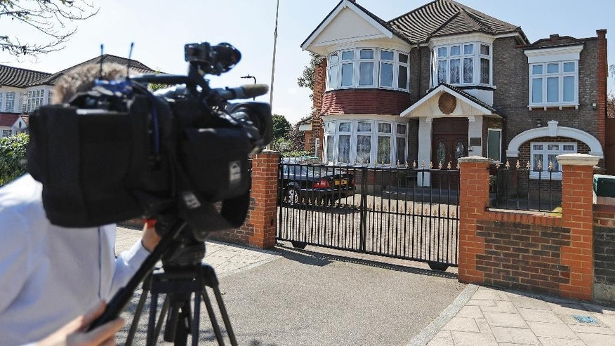 A camera man films the entrance of the North Korea Embassy in London, Wednesday, Aug. 17, 2016. A senior North Korean diplomat based in London has defected to South Korea, becoming one of the highest Northern officials to do so, South Korea said Wednesday. Thae Yong Ho, minister at the North Korean Embassy in London, has arrived in South Korea with his family and is under the protection of the South Korean government, Seoul's Unification Ministry said. (AP Photo/Frank Augstein)