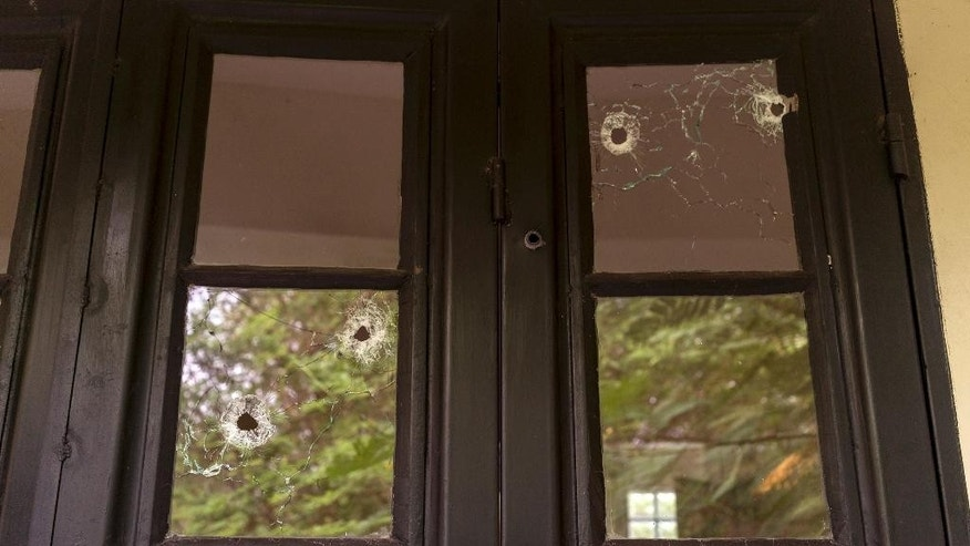 In this photo taken Wednesday, Aug. 3, 2016 and released by Adriane Ohanesian, bullet holes are seen in the window of a room at the Terrain compound after it was looted the previous month in the capital Juba, South Sudan. On July 11, South Sudanese troops, fresh from winning a battle in Juba over opposition forces, went on a nearly four-hour rampage through a residential compound popular with foreigners, in one of the worst targeted attacks on aid workers in South Sudan's three-year civil war. (Adriane Ohanesian via AP)