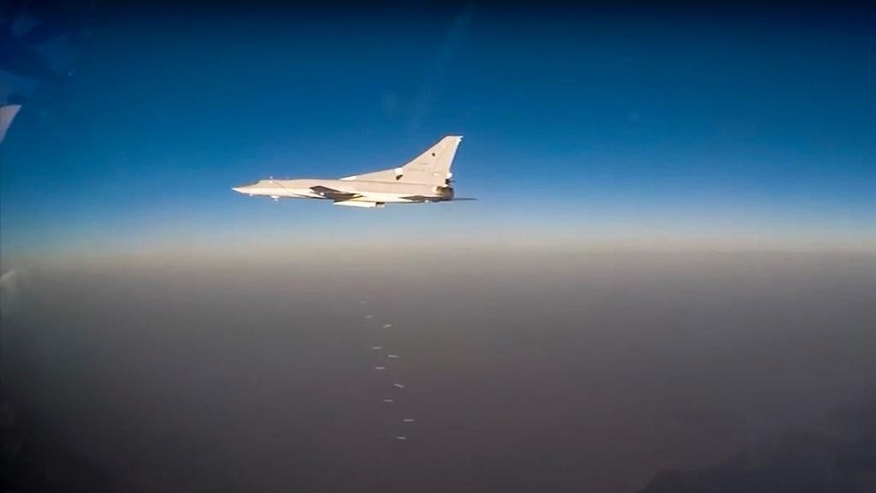 In this frame grab provided by Russian Defence Ministry press service Russian long range bomber Tu-22M3 flies during an air strike over Syria on Thursday, Aug. 18, 2016. Russia's Defence Ministry said on Tuesday Russian warplanes have taken off from a base in Iran and in Russia to target Islamic State fighters in Syria. (Russian Defence Ministry Press Service photo via AP)