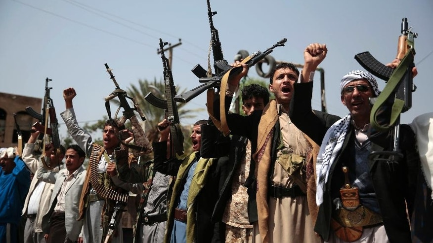 Tribesmen loyal to Houthi rebels hold their weapons as they chant slogans during a protest against Saudi-led airstrikes that hits a hospital supported by Doctors Without Borders in northern Yemen, in Sanaa, Yemen, Tuesday, Aug. 16, 2016. (AP Photo/Hani Mohammed)