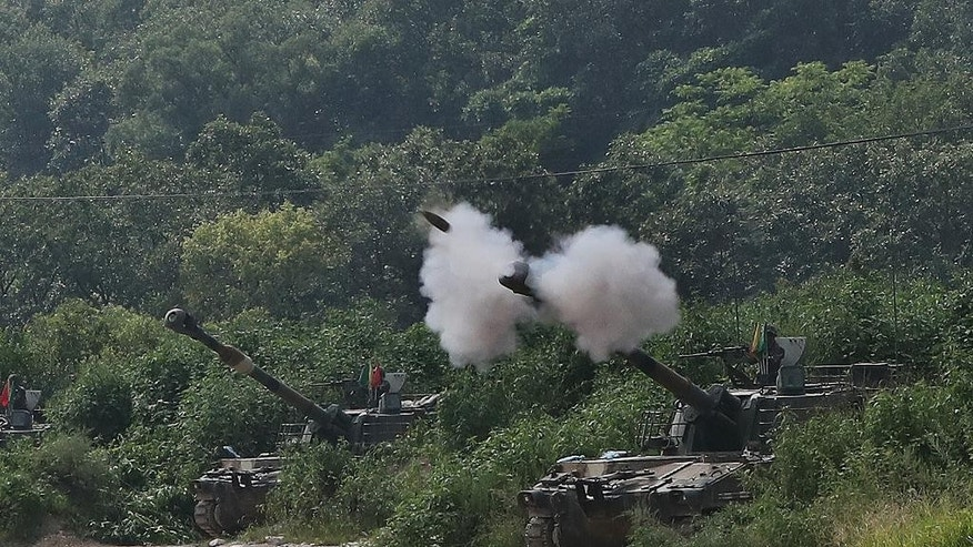 A South Korean army's K-55 self-propelled howitzer fires during a military exercise in Yeoncheon near the border with North Korea, South Korea, Thursday, Aug. 18, 2016. South Korea's army says it has conducted its largest-ever artillery drills near the tense border with North Korea. (Lim Byung-shick/Yonhap via AP)