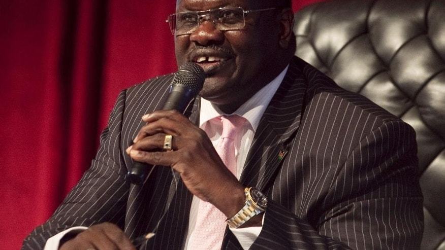 FILE--- In this file photo of Wednesday, Oct.13, 2010, Dr. Riek Machar, Vice President of the Government of South Sudan, presides over an all-southern-parties meeting in Juba, SudanSouth.  Sudan's rebel leader Machar  has fled the country, a spokesman for his party said Thursday Aug. 18. 2016 . The former First Vice President Riek Machar has gone to a safe country in the neighboring East African region, Mabior Garang, a spokesperson for the SPLM-IO party, said in a posting on Facebook.(AP Photo/Pete Muller-file)