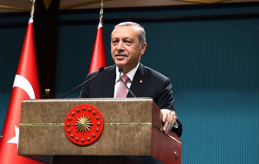 "Turkey's President Recep Tayyip Erdogan speaks after an emergency meeting of the government in Ankara, Turkey, late Wednesday, July 20, 2016. Erdogan on Wednesday declared a three-month state of emergency following a botched coup attempt, declaring he would rid the military of the ""virus"" of subversion and give the government sweeping powers to expand a crackdown that has already included mass arrests and the closure of hundreds of schools.(Kayhan Ozer/Pool Photo via AP)"