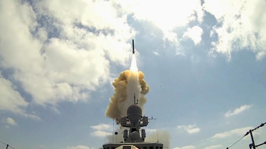 In this frame grab provided by Russian Defense Ministry press service, long-range Kalibr cruise missiles are launched by a Russian Navy ship in the eastern Mediterranean, Friday, Aug. 19, 2016. The Russian military says two of its ships have launched cruise missiles at targets in Syria from eastern Mediterranean. (Russian Defence Ministry Press Service photo via AP)